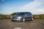 Stylish Polished Avant Garde Rims Enhancing Gray Nissan Versa