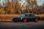 Mafia's Ride: Custom Black Plymouth Barracuda on Candy Red Buttoms