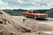 Orange Pontiac GTO Rolling on Chrome Wheels