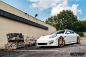White Porsche Panamera Reworked with Gold Wheels and Crystal Clear Halo Headlights