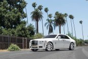 Custom White Rolls Royce Ghost Enhanced with Chrome Grille and Other Exterior Goodies