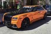 Distinctive Blacked Out Billet Grille on Orange Rolls Royce Ghost