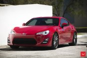 Apple Red Red Scion FRS Showing Off Crystal Clear Headlights and Chrome Rims