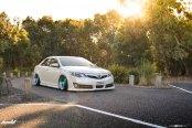 Candy Blue Avant Garde Rims Ehnancing White Toyota Camry