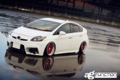 Fitted with Stylish Tweaks White Toyota Prius Wears Red Avant Garde Wheels
