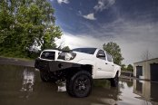Off-Road Monster: Modified White Toyota Tacoma