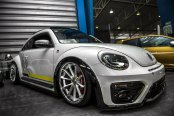 Customized to Impress: White Volkswagen Beetle Dressed in Aftermarket Parts
