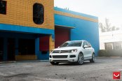Blending In and Standing Out: White Volkswagen Touareg on Chrome Wheels