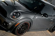 MAXXIM® - MAZE Black with Red Stripe on Mini Cooper