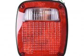Omix-Ada® - Black Replacement Housing Tail Light (Left)
