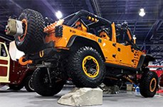 RUGGED RIDGE® - 15301 Satin Black with Orange Rim Protector on Jeep Wrangler
