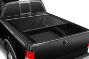 Image may not reflect your exact vehicle!Truck Covers USA® - American Roll Black Tonneau Cover, Mid Open