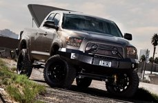 Open UnderCover® - Se Smooth™ Tonneau Cover on Lifted Truck