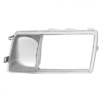 URO Parts® - Headlight Door Bezel