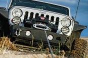 Warn® - 10000 lbs 12V DC ZEON™ 10-S Electric Winch with Spydura™ Synthetic Rope in Use